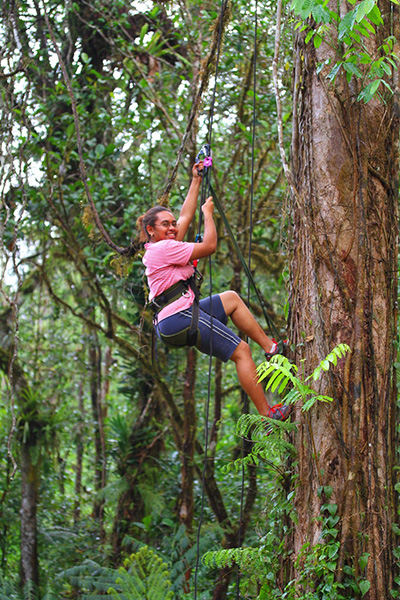 Sereana Maramayawa climbing a tree in Nabukelevu, Viti Levu, searching for iguana nests in the trees. Photo by Adam Clause.