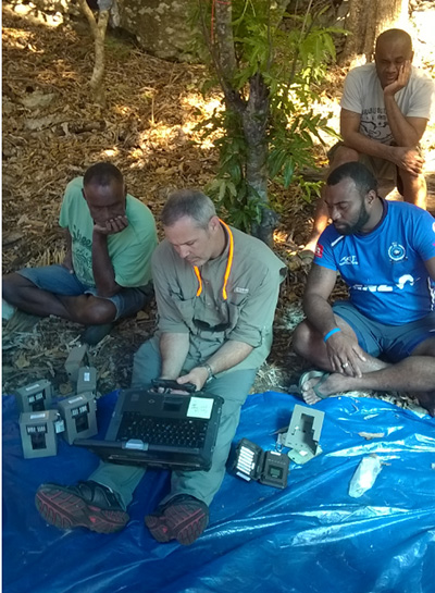 Training Rangers on downloading and processing photos taken by remote cameras.