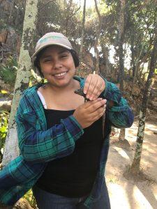 Student Sobeida with Juvenile Roatan Spiny-tailed Iguana during 2019 workshop