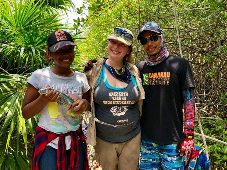 The field team and Student Gisele Bodden with a Utila Spiny-tailed Iguana (Swamper)