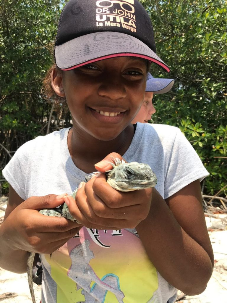 School of Nature student Gisele with a male Swamper on field trip to west side of island – Daisy Maryon